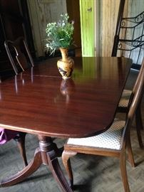 Duncan Phyfe dining table has 2 leaves; the different style chairs are sold separately.