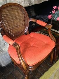 One of two cane armchairs (The chairs would be perfect as host chairs at your dining table.)