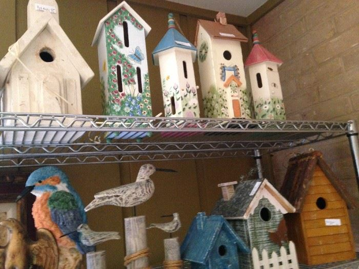 Bird houses and carved birds