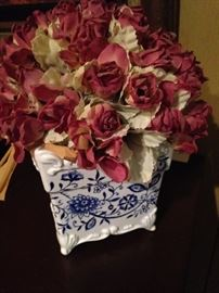 Artificial roses in blue & white planter