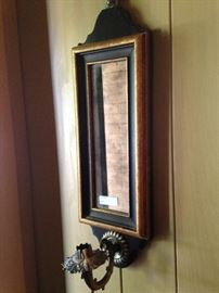 One of two candle holder wall mirrors