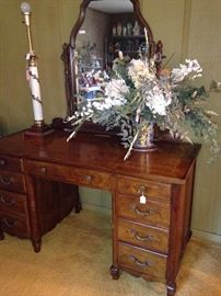 Lamp, dresser with mirror, and artificial arrangement