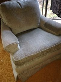 Pale green club chair has matching ottoman