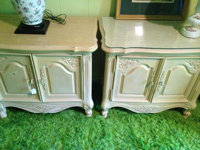Two yellow nightstands (1 has custom shaped glass on the top)