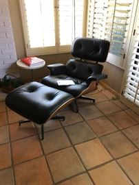 new Eames Herman Miller lounge chair and ottoman with tags still attached!