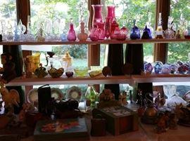 Vintage glassware, some vintage wood puzzles, bottom corner is a signed Brad Keeler cockatoo