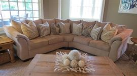 Living Room Beige Sofa - microsuede with throw pillows, distressed wood coffee table and side table