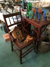 Cuckoo clock, chair with cane seat