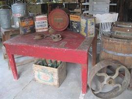 oil cans, soda crate, wooden barrel