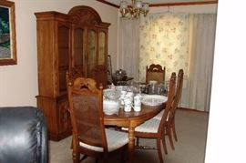 Late 60's- Early 70's table , china cabinet, and chairs.. Very nice..