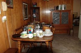 Plenty of Kitchen items, cook books, etc.. Notice the very nice turn of the century Pie Safe..
