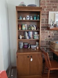Two matching curio/bookshelf units. Only one shown in above photo.