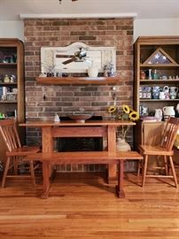 Pennsylvania Amish made solid oak table, bench and three chairs.