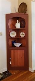 Corner Hutch with three shelves and lower cabinet.