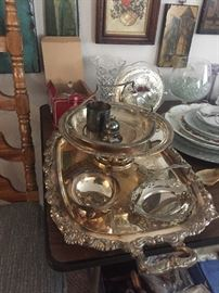 Many sets of silver and china.