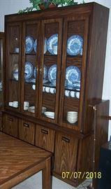 China hutch ( 54 in. W x 15 in. D x 79 in. H) w / English Village and Nautilus china.
