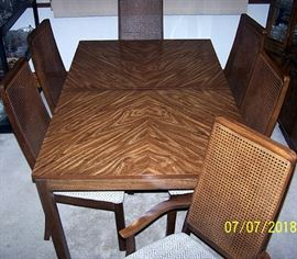 Dining room table (40 in. W x 62 in. L), one 12 in. leaf and 6 chairs