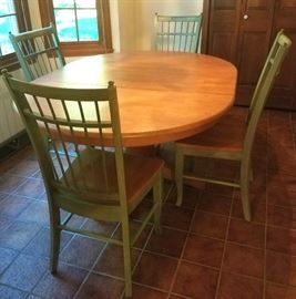 Pedestal table has self storing leaf & four side chairs