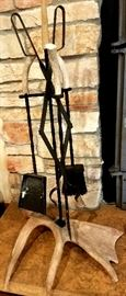 Fireplace tool stand has horn base