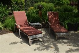 Patio chaise lounge chairs and small table