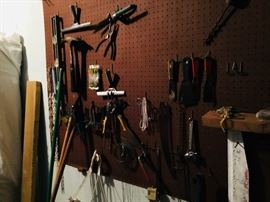 A WALL OF TOOLS AND GARAGE
