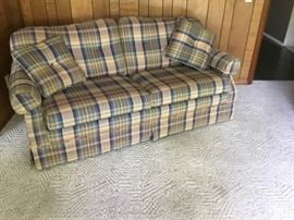 Blue and green plaid sofa