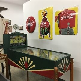 This pinball machine from the 30s and the Coca-Cola signs are part of the auction.