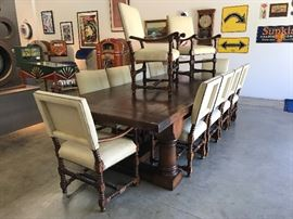 This 11ft Spanish Revival dining table and chairs is part of the auction.