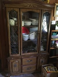 One of two formal china cabinets.