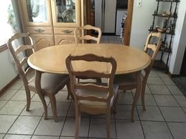 If you like lighter wood, this table and chairs with matching china cabinet is a great set.