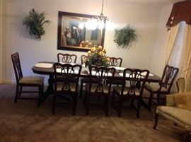 Mahogany formal dining table set w/two leaves and pedestal claws feet. Ivory bottom chairs still in plastic (pic 2 of 2).