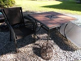 Patio table with 4 stacking chairs, rolling plant stands