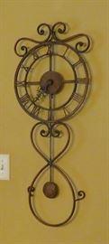 Pendulum scroll quartz clock