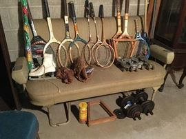 Vintage sports equipment and airplane seats.