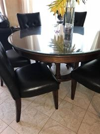 ROUND WOODEN TABLE AND 8 CHAIRS