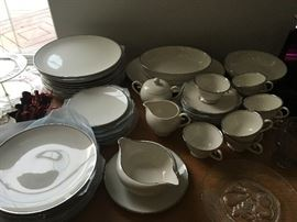 Flintridge service for 8. Includes gravy bowl, cram and sugar and serving bowls.