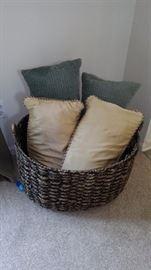 Basket and throw pillows