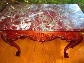 Shell-motif marble-top table with claw and ball feet