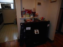 Bar table has sides that open for storage and lazy susan center.