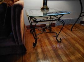 Iron and glass end table. There are two.