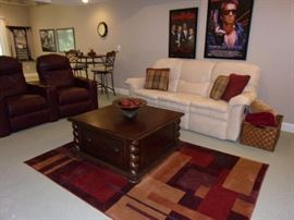 Microfiber off white/cream stunning excellent condition sofa/dual reclining couch, Barley twist corner coffee table with drawers, 2-Leather theater seating with cup holders, full recline, and snack/computer trays to mount on arm in storage area.  Pub height table and bar stools. Projection screen not for sale