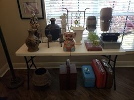 Pottery vases urns and more.  Vintage suitcases basket African face masks