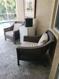 Part of an outdoor patio chair set with cushions