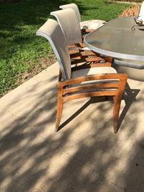 Teak chairs, glass patio table