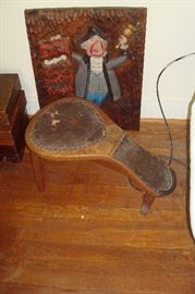 Old antique cobbler's bench and wood carving.