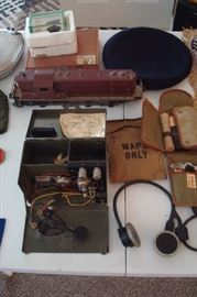 WW 2 Morse code transmitter, old Lionel train engine & other military items.