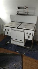 Fabulous, white enamel and chrome gas stove with Bakelite knobs