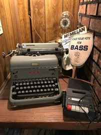 Vintage typewriter, vintage advertising pieces (fans) Anniversary clock, voice recorder