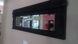 Heavily carved beveled mirror