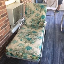Vintage chaise lounge with cushion